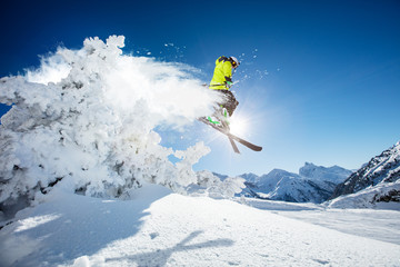 Fototapete - Skier at jump in Alpine mountains