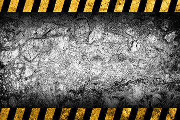 Grunge grey marble background with black and yellow warning stripes