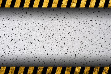 Grunge grey background with black and yellow warning stripes