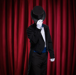 magician with top hat on stage