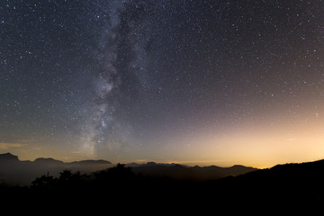 Milky way landscape over mountain silhouette