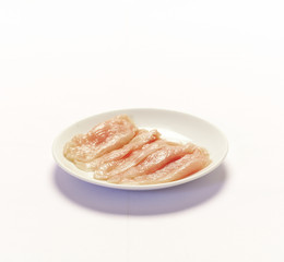Raw uncooked chicken breast isolated on white background