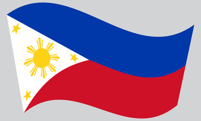Flag of the Philippines waving on gray background