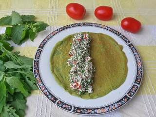 Cooking green roll with weed and tomatoes, organic food