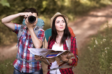 Travelling Couple viewing local Attraction and navigating a Map
