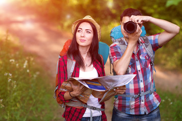 Boy and Girl traveling together with Map and Camera