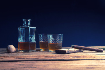 Whisky and cigar on wooden table
