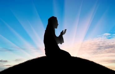 Muslim prays at sunset