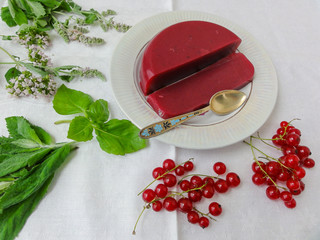 Red jelly berries on plate, with mint decorated, organic healthy
