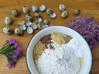 Cooking knapweed cake with quail egg, weed and flax seeds