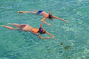 two girls and the fish swim with masks from the Red Sea, Egypt