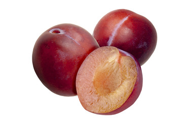 Fresh red plums, in a cut, on white background.