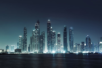 panorama of skyscrapers in Dubai Marina, sunset time, UAE