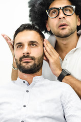 businessman and popular hairdresser beautify the hair in the pri
