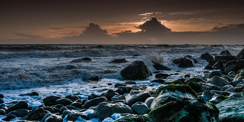 Stormy sea at Sunset, on the Isle of Wight, England