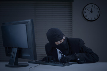 Burglar takes information in office