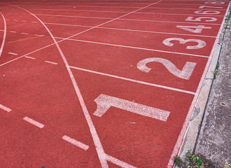 Numbers on running tracks in athletic stadium.