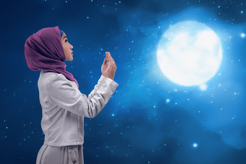 Young woman asian muslim praying to god