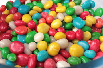 a heap of colorful round candy sugar pills