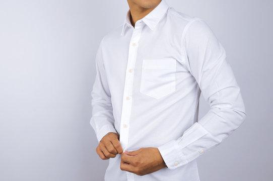 A man wearing a white shirt. White background.