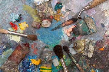 Paint brushes and old pallet