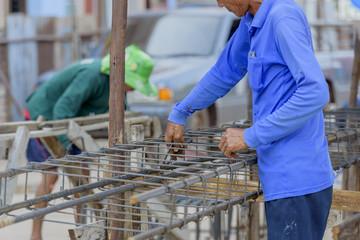 Workers tied steel construction
