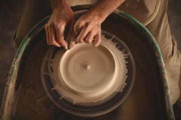 Hands of potter making a pot