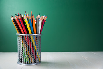 color pencil box on wooden table
