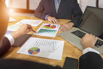 Business people analyzing investment charts in meeting room, Acc