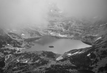 misty black and white lake