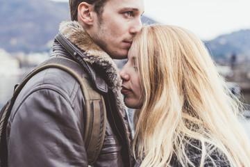 Romantic young man kissing girlfriends forehead, Lake Como, Italy