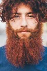 Close up portrait of young male hipster with red hair and beard