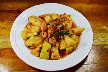 spicy stir fried winter melon with minced pork on dish