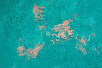 fragment of the old wall, painted bright turquoise paint, cracked over time.