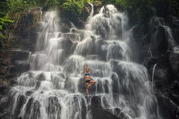 serenity and yoga practicing at waterfall Kanto Lampo, Bali,Indonesia