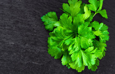 Delicious organic fresh parsley on wooden background photographed on top