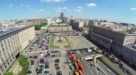 Townscape with traffic on Triumph Square at spring sunny day. Aerial view