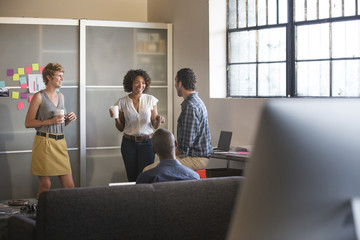 Young business people talking in office