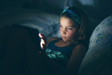 Girls in bed using digital tablet