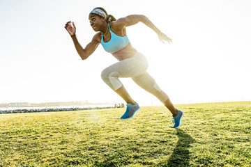 Young woman training, sprinting at coast, downtown San Diego, California, USA