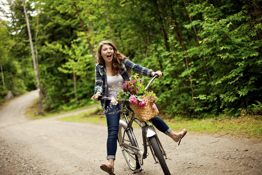 Girl riding bicycle on dirt path