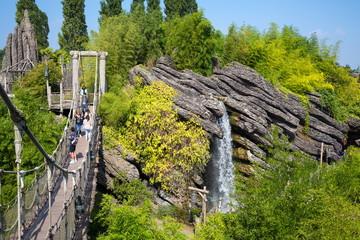 Waterfall and suspension bridge in Pirates beach on Disneyland.