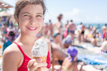 girl with ice-cream cone on the beach