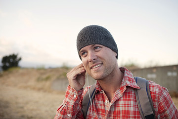 Man putting in earbuds in remote area