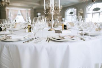 Elegant wedding reception white table arrangement restaurant,  candlestick on table