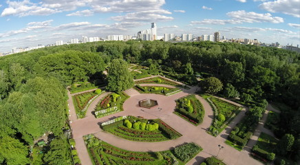Cityscape with rose garden at summer sunny day. Aerial view