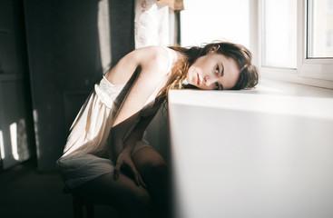 Caucasian woman leaning on windowsill