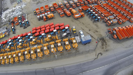 Aerial view of new equipment row on the parking.