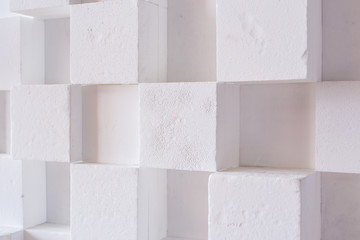 abstact modern architecture background with white cubes on the wall