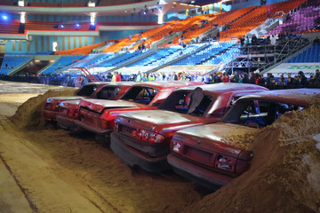 Junk cars in arena at show Monster X Tour in Olympic Sports Complex